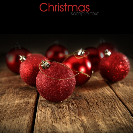 red baubles on black background photo