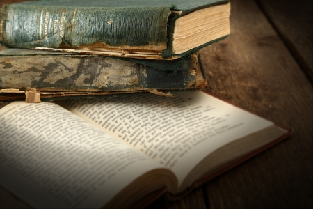 open book on rustic table photo