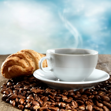 cup of coffee with fresh croissant photo