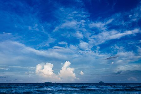 Bright and beautiful photos of heavenly white clouds and saturated blue sky with sunlight. Light, delicate and airy cloudy background with white and blue colors. Place to print. Nice background