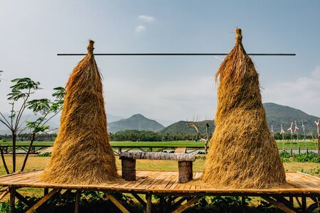 Hay, haystack, agriculture, cart. Rural landscape, view of rice fields, beautiful view of mountains, rivers and a farm village. Blue sky with white clouds. Beautiful asian landscape