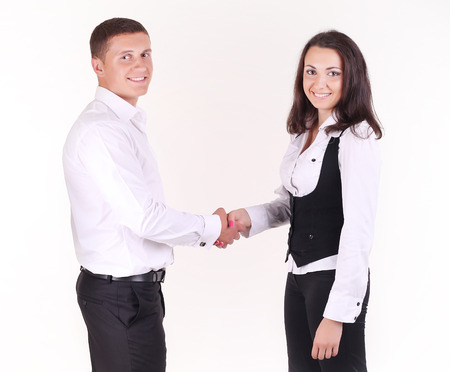 new employee: A businesswoman welcoming a new employee to the company. Multi-ethnic business team. Stock Photo