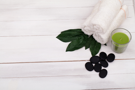perfumed: Spa still life with lavender oil, white towel and perfumed candle on natural wood. Stock Photo