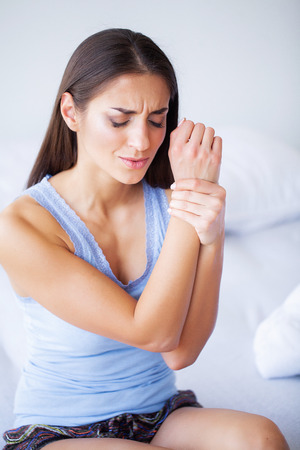Woman Wrist Arm Pain. Office Syndrome Healthcare And Medicine Concept