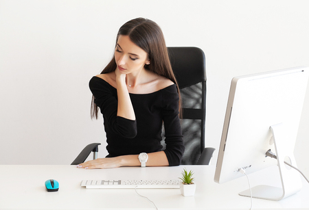 Pain neck. Tired business woman holding her neck Stockfoto