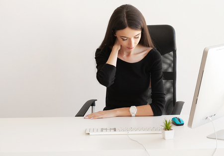 Pain neck. Tired business woman holding her neck