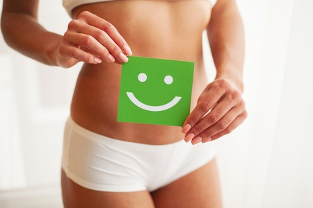 Women Health. Beautiful Female Body In Panties With Smile Card