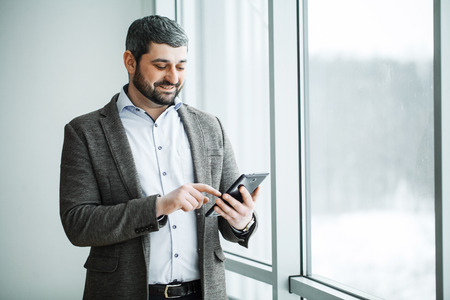 Business man pressing button bitcoin on tablet