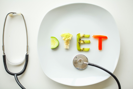 Diet. Close up of plate with vegetable diet letters Zdjęcie Seryjne