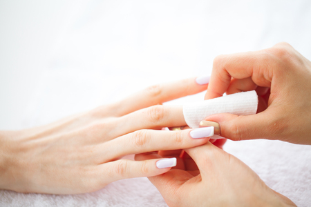 Hand and Nail Care. Beautiful Womens Hands with Perfect Manicure. Manicure Master Holding Cotton Pads in Hands. Beauty Day. Spa Manicure