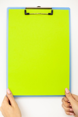 Blank Folder with Green Paper. Hand that Holding Folder and Handle on White Background. Copyspace. Place for Text