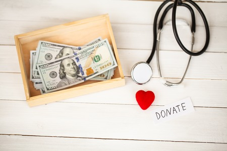 Donation Concept. Box with Dollars on White Background. Donations. High Resolution Stock Photo