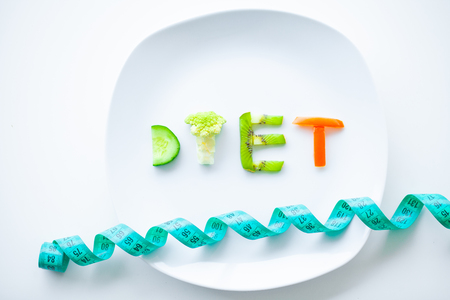 Diet or Weight Control Concept. Close Up of Plate With Vegetable Diet Letters. Fitness and Healthy Food Diet Concept.