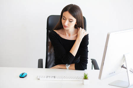 Pain. Beautiful Businesswoman suffering pain on her office