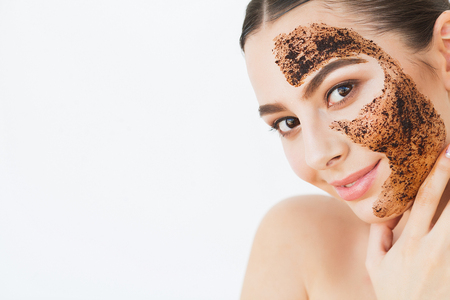 . Young CFace Skincareharming Girl Makes a Black Charcoal Mask on Her Face