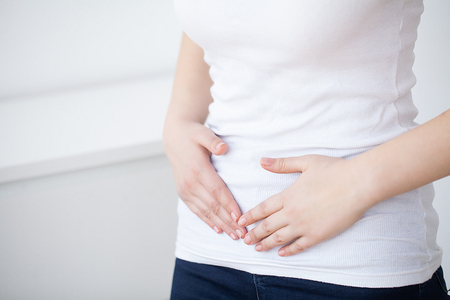 Stomachache. Woman Having Painful Stomachache, Female Suffering From Abdominal Pain