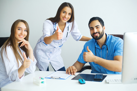 Happy Successful Medical Team work together in hospital