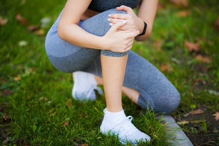 Leg Injury. Beautiful Woman Feeling Pain In Knee
