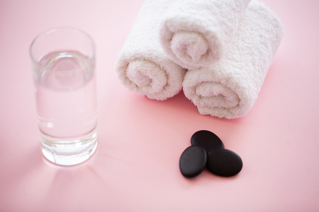 Spa. White Cotton Towels Use In Spa Bathroom on Pink Background. Towel Concept. Photo For Hotels and Massage Parlors. Purity and Softness. Towel Textile