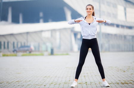 Sporty Girl Exercise At Park On Modern City Background