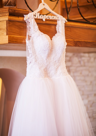The perfect wedding dress with a full skirt on a hanger in the r