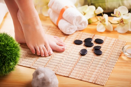 Closeup photo of a beautiful female feet with french pedicure Stock Photo