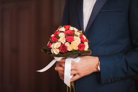 big wedding bouquet in groom hand