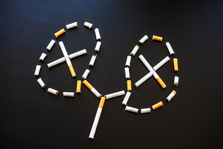Stop smoking concept on background with broken cigarettes. Heap of cigarettes. No smoking 免版税图像