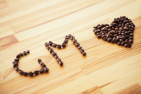 Good Morning. Coffee Time. Coffee to go and beans on a wooden background