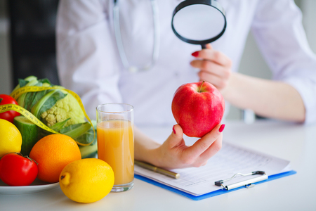 Some Fruits Such As Apples, Kiwis, Lemons And Berries On Nutritionist Table Zdjęcie Seryjne