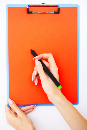 Blank Folder with Red Paper. Hand that Holding Folder and Pen on White Background. Copyspace. Place for Text
