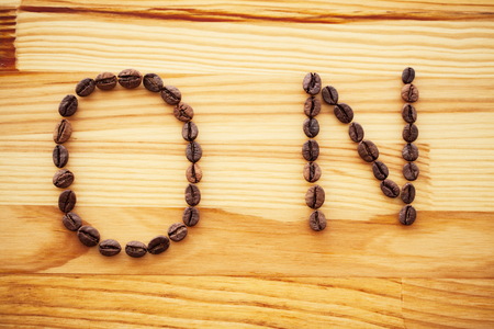 Good Morning. Coffee Time. Coffee beens on a wooden background