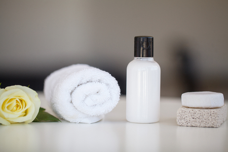 Wellness Products and Cosmetics. Spa still life with blossoms of rose and essential oils