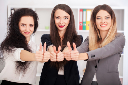 Teamwork concept, brainstorming. Businessman crew working with new startup project in modern loft. Woman holding smartphone hands. Horizontal