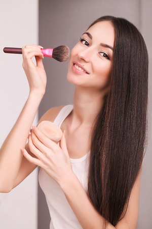 cosmetics, health and beauty concept - beautiful woman with closed eyes and makeup brush 写真素材