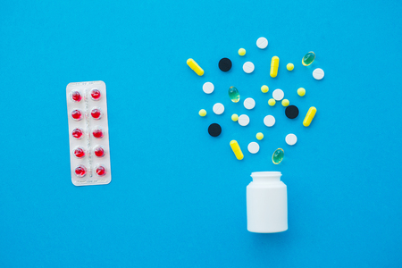 Medical Pills. Colored Pills And Capsule On Blue Background. Pharmacy Theme, Capsule Pills With Medicine Antibiotic in Packages 写真素材