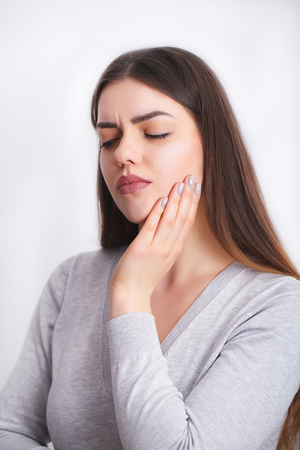 Tooth Pain. Beautiful Woman Feeling Strong Pain, Toothache Stock Photo