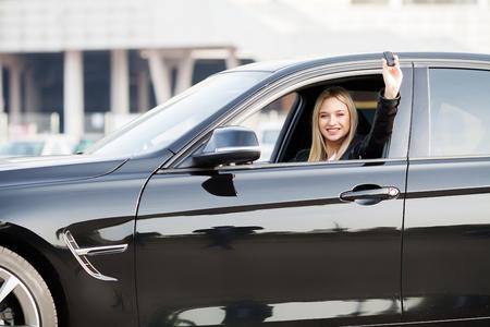 Woman Driver Holding Car Keys siting in Her New Car Zdjęcie Seryjne