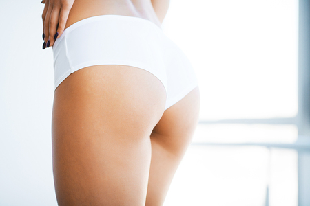 Healthy lifestyle and Diet concept. Closeup Of Beautiful Slim Woman Body With Sexy Buttocks, Big Ass
