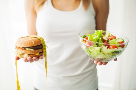 Diet and Healthy eating. Young woman eating healthy salad after workout Stock Photo