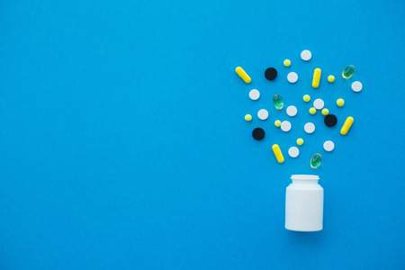 Pharmacy and pills. Medicines, Supplements and Drugs in a Bottle on Blue Background 写真素材