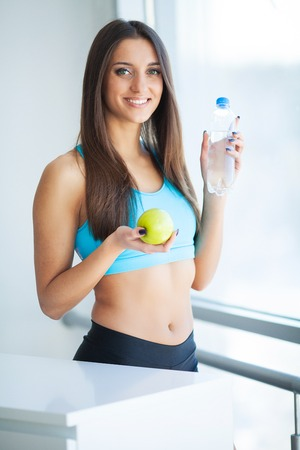 Diet and Drinking Water. Woman with bottle of water