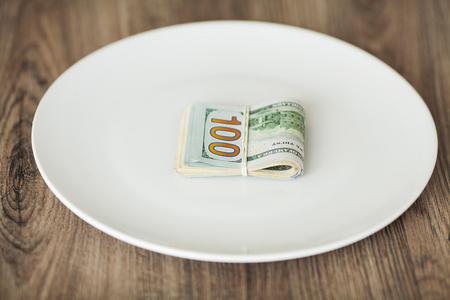 Plate with money. Greedy corruption concept. Bribe idea Stock Photo