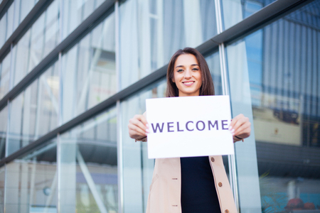 Travel. Women business with the poster with welcome message Stock Photo