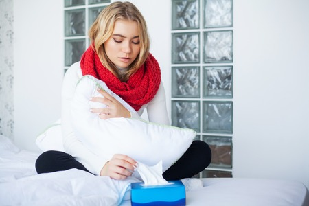 Fever And Cold. Portrait Of Beautiful Woman Caught Flu, Having Headache And High Temperature. Closeup Of Ill Girl Covered In Blanket, Feeling Sick Holding Thermometer. Health care. High Resolution Stock Photo
