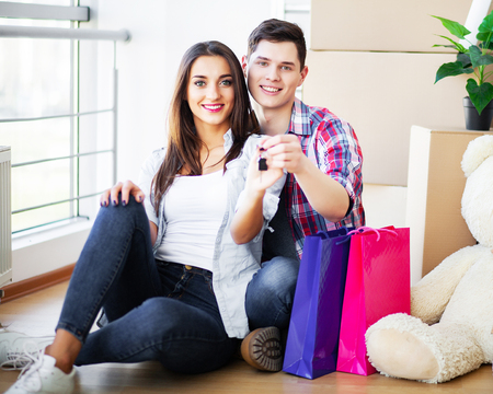 Happy young couple moving together in new apartment Stok Fotoğraf