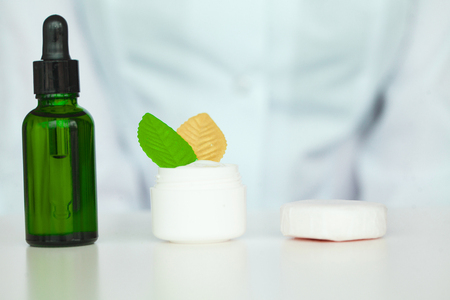 Scin Care. Scientist hands testing texture of beauty products Stock Photo