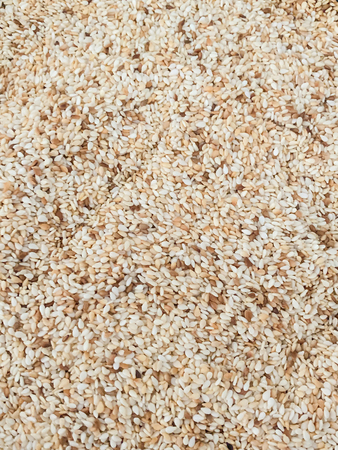 Toasted white sesame seeds full frame background
