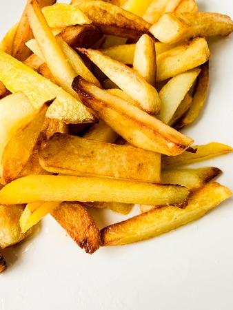 Teasty food. Fried potato on white plate