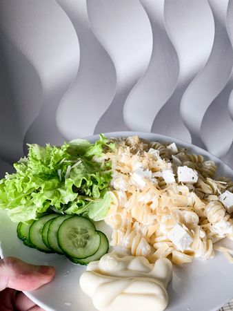 Fresh green salad with feta cheese and pasta